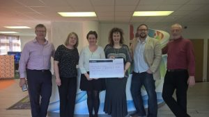 Staff from Finch Group present cheque to trustees at Building for the Future.